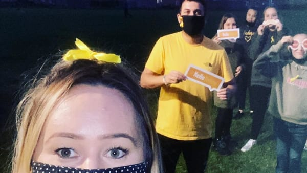 Youth Moves supports mental health awareness by wearing yellow